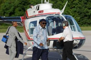New Light Christian Center megachurch pastor Bishop I.V. Hilliard (sunglasses) exits church helicopter   for which he now seeks a financial seed from members for a blade upgrade.