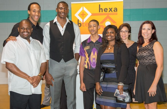 VATG devotional writer Herbert Bowen, Jr. (black shirt) and  founder of B.T.E.P. (Bringing Together Extraordinary People), poses with his BTEP team and partners, Charlotte Hornets center Bismack Biyombo and 14-year-old Charlotte race car driver Matt Murphy IV (purple shirt) to host their first annual fundraiser on May 14, 2015 to purchase new equipment and uniforms for a disadvantaged high school baseball team.