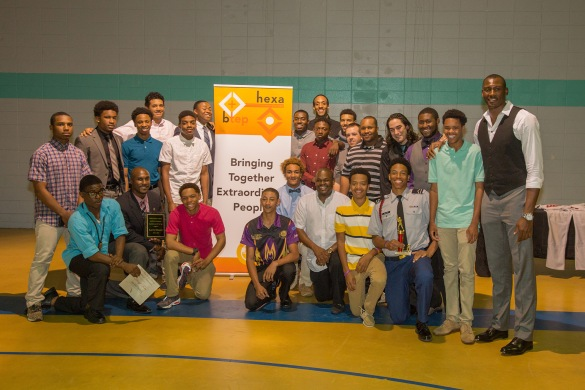 VATG devotional writer Herbert Bowen, Jr. (black shirt to right of sign), and founder of B.T.E.P., poses with his team, Charlotte Hornets center Bismack Biyombo, coaches and players of the Phillip O. Berry Academy of Technology baseball team at B.T.E.P.'s kickoff event on May 14, 2015 to raise funds to purchase new equipment and uniforms for the baseball team in Charlotte, N.C. (Photo courtesy Ken Bebe)