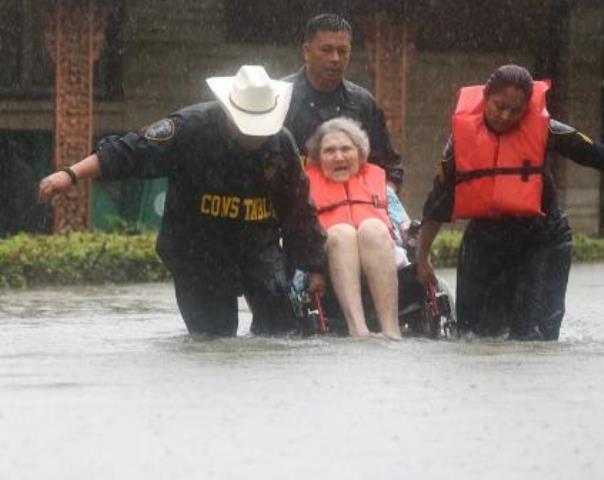 Hurricane Harvey police officers rescue elderly woman